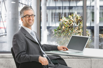 Businessman working on laptop