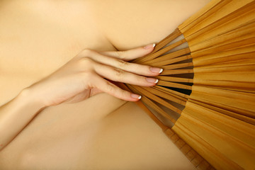 Denuded girl with fan.