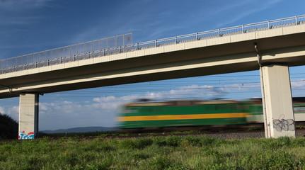 Fast train passing under a bridge