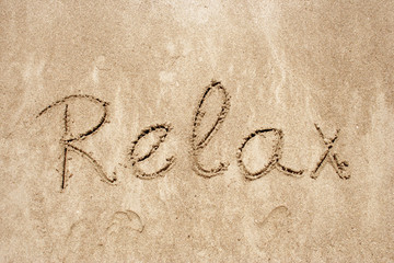 Relax handwritten in sand for natural, symbol,tourism