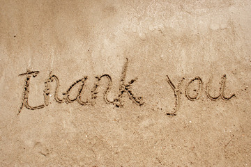Thank you handwritten in sand for natural, symbol,tourism