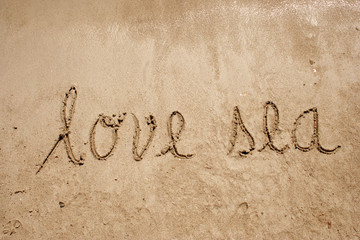 Love beach handwritten in sand for natural, symbol,tourism