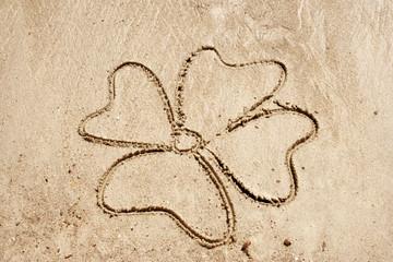Clover symbol drawn in sand for natural, symbol,tourism