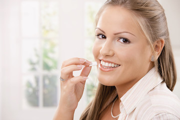 Beautiful woman eating chewing gum