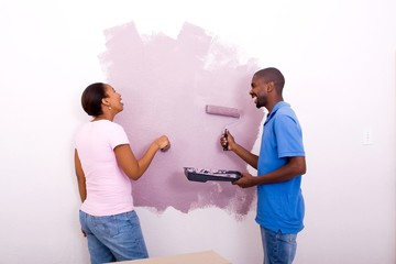 laughing couple painting