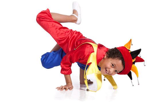 Breakdancing boy dressed in clown costume