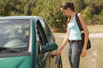 woman with key open car door