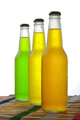 Three bottles with tropical drink on white background
