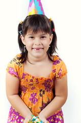 little girl throws confetti celebrating