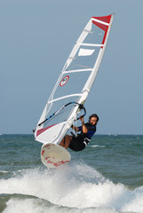 windsurf jumping over wawe 3