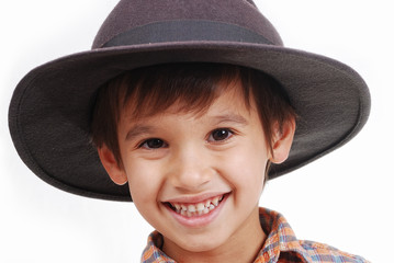 Very cute kid with hat on his head, isolated