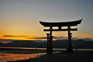 Torii gate of a temple during sunset