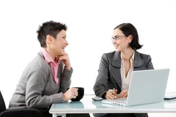 Young businesswomen talking