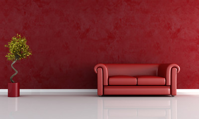 red living room with classic sofa against stucco wall