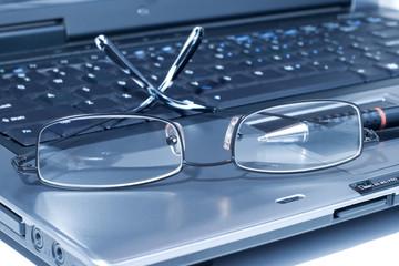 Eyeglasses on lap top
