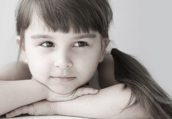 Girl child with a sly glance