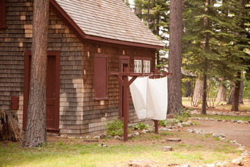 Classic Vintage Log Cabin with Hanging Sheets