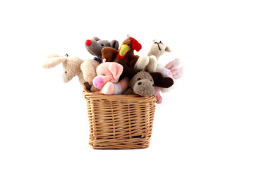 Soft toys in a wattled basket