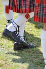 man in kilt tapping foot