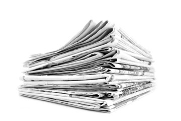 Stack of isolated newspapers in black and white
