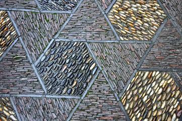 Mosaïque de briques et galets