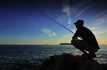 Tuinposter Vissen Man fishing on sunset