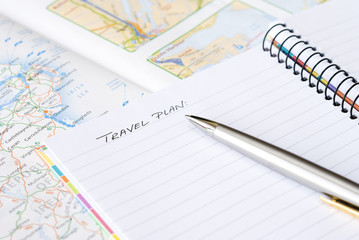 Spiral notebook with pen and map