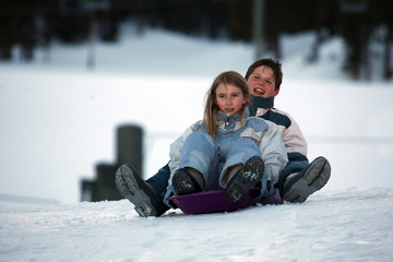 two kids on sled