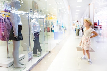 young little girl in shopping mall