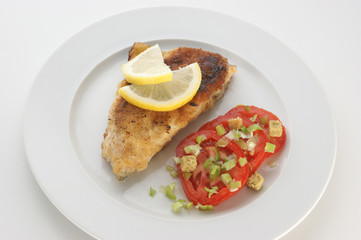 grilled carp fillet with tomato and herbs