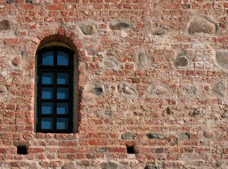 Window and ancient castle wall
