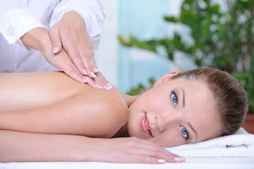Massage for young woman in the spa salon