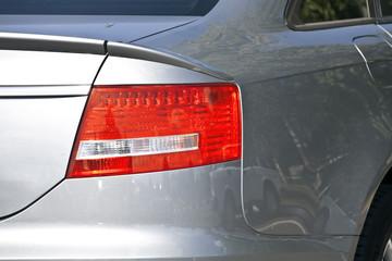 brake lights of modern gray metallic car