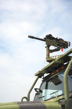 Machune gun on military truck