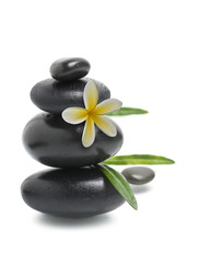 Spa still life, Stack of pebbles with yellow flower