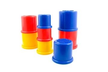 stacked plastic toys over white background
