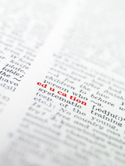 The word 'education' highlighted in a dictionary