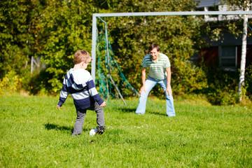 Family playing football
