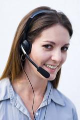 woman operator answering costumers telephone calls