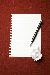Paper ready for writing on red background