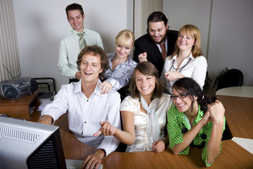 Young people laughing and pointing at the computer screen