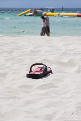 Beach slippers in the sand