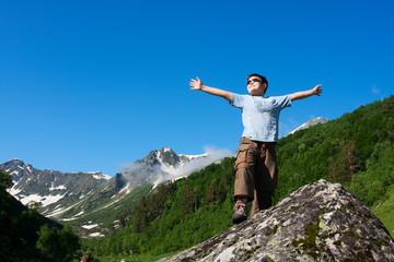 Happy boy in Caucasus mountains