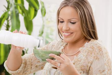 Woman drinking yogurt