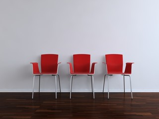 Three modern red Chais to face a blank white wall