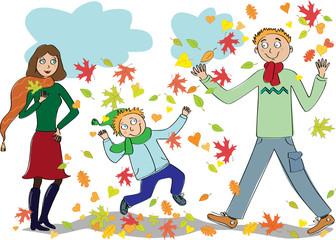 Family walks in the  autumn park
