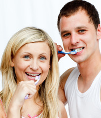 Portrait of a couple cleaning their teeth