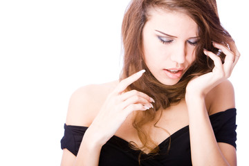 young woman touching her long hair twisted over her neck