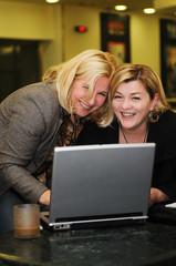 happy mature woman work on laptop