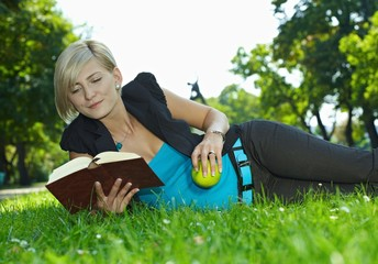 Woman reading book outdoor